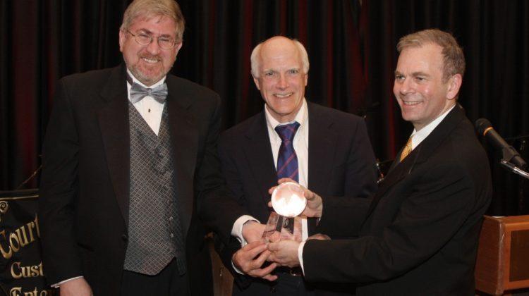 HBF Chairman Joel Rosen and HBF President Dr. Timothy Block present award to Dr. Brian McMahon